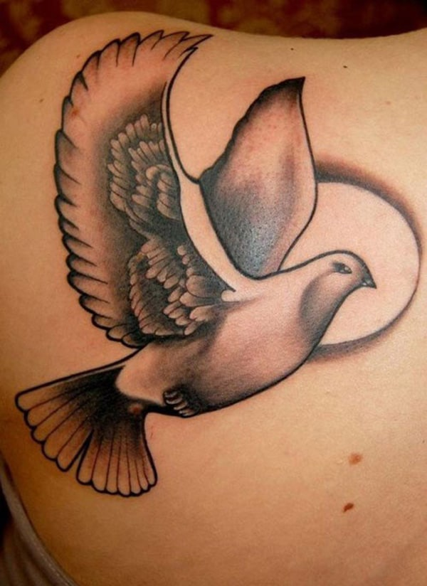 Dove tattoo on back